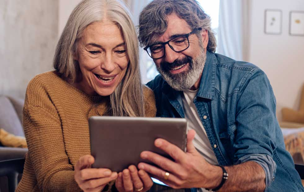 A couple is excited to start their free membership with Population Health and get the benefits they deserve
