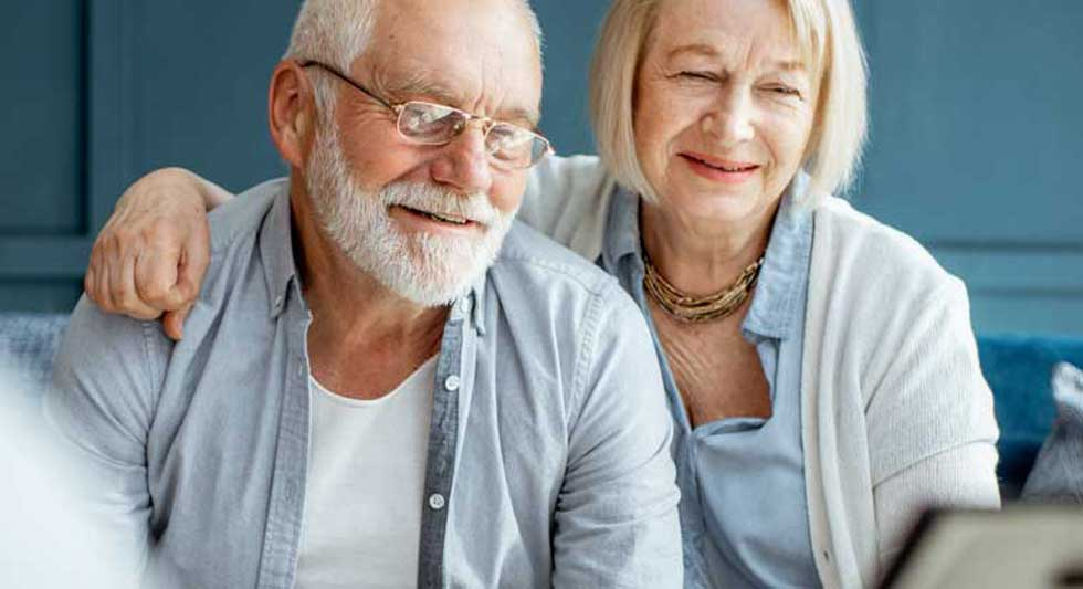 An older couple learns about the three main ways Population Health improves their customers care