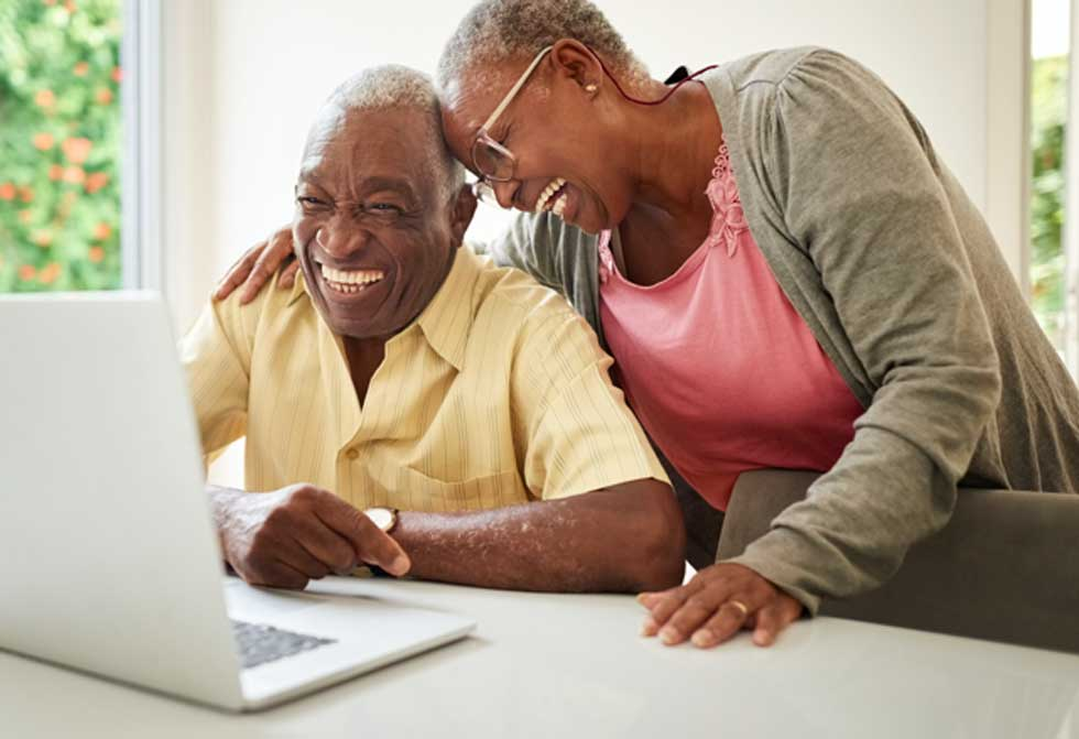 An older couple enjoy their time together as they learn more about the benefits Population Health helps customers receive